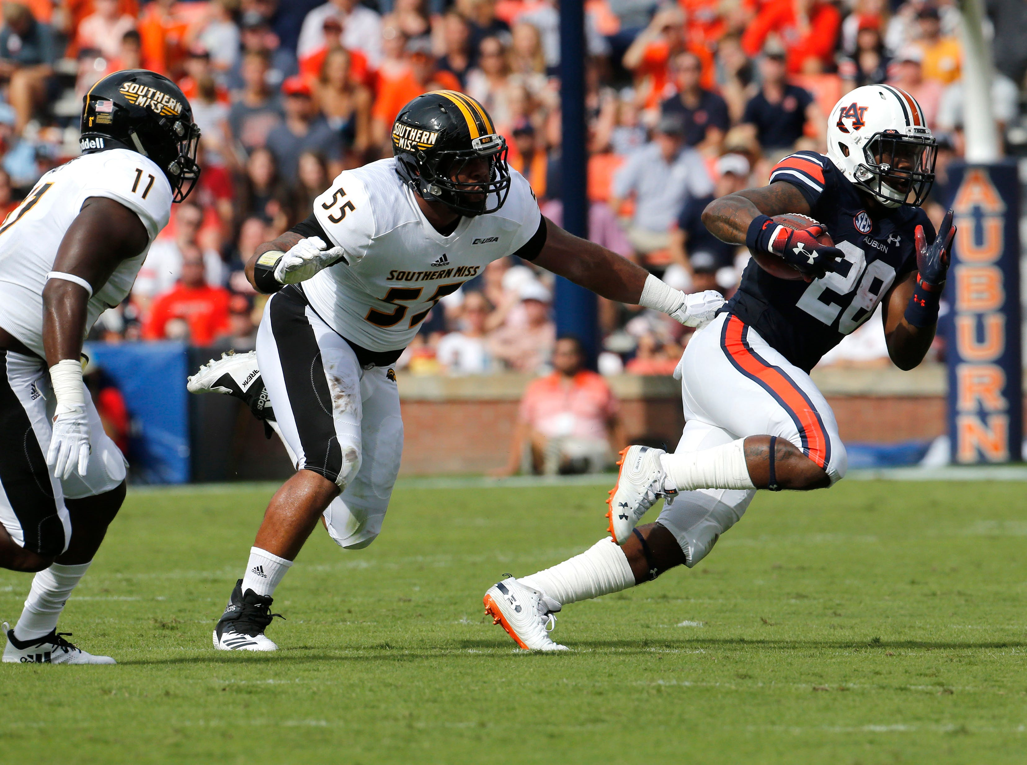 Sep 29, 2018; Auburn, AL, USA; Southern Miss Golden Eagles lineman Demarrio Smith (55) closes in on Auburn Tigers running back JaTarvious Whitlow (28) during the first quarter at Jordan-Hare Stadium. Mandatory Credit: John Reed-USA TODAY Sports