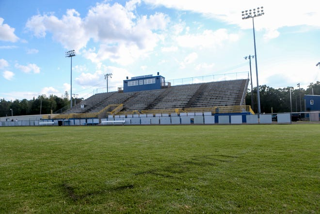 """""""L-TOWN"""" can be seen spray painted on the football field after more than 100 volunteers assisted in painting over vandalism spray painted on facilities and buildings around the football field at McNairy Central High School in Selmer, Tenn., on Sunday, Sept. 30, 2018."""