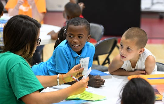 Tiffany Matlock working with Jayvion Love and Reuben Mullins at the Cedarbrook Outreach program at West Park Baptist Church Tuesday, September 25, 2018.