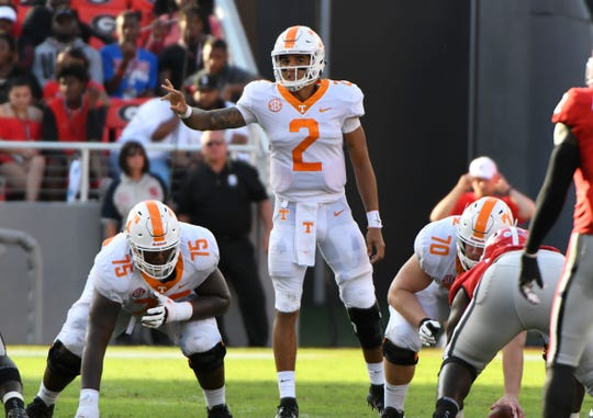 Tennessee quarterback Jarrett Guarantano (2) calls a audible play from the line during second half action against Georgia Saturday, September 29, 2018 at Sanford Stadium in Athens, GA. Tennessee offensive linemen are Jerome Carvin (75) and Ryan Johnson (70).
