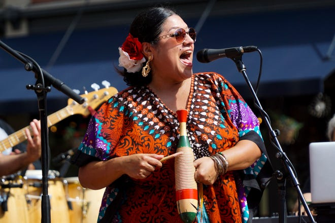 A member of Soul Sacrifice, a Santana tribute band, performs on the stage in Market Square during the annual HoLa Festival on Sunday, September 30.
