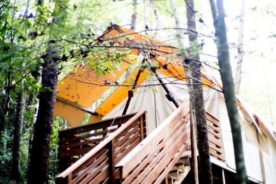 A tent in the woods at Under Canvas Great Smoky Mountains in Pigeon Forge, Tenn., on Saturday, Sept. 29, 2018.