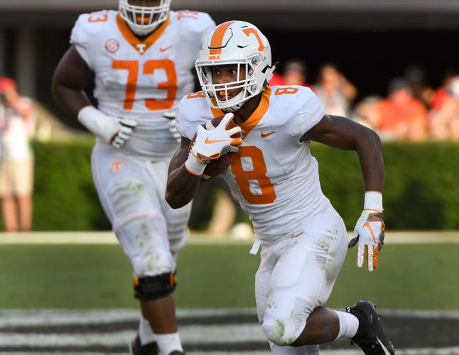 Tennessee running back Ty Chandler (8) heads toward the end zone during second-half action against Georgia Saturday, September 29, 2018 at Sanford Stadium in Athens, Ga.