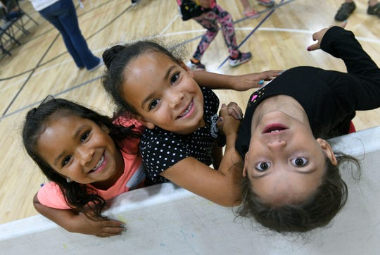 Ande Johnson, Amir Johnson, and Patience Tate clowning around during play time at Cedarbrook Outreach program at West Park Baptist Church Tuesday, September 25, 2018.
