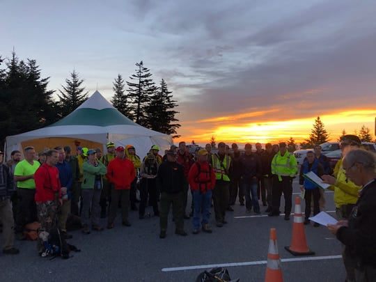 """Search crews at the morning briefing at Clingmans Dome on Saturday, Sept. 29, 2018, in the hunt for Mitzi """"Susie"""" Clements, 53, of Ohio, who has been missing in the Great Smoky Mountains National Park since Tuesday."""