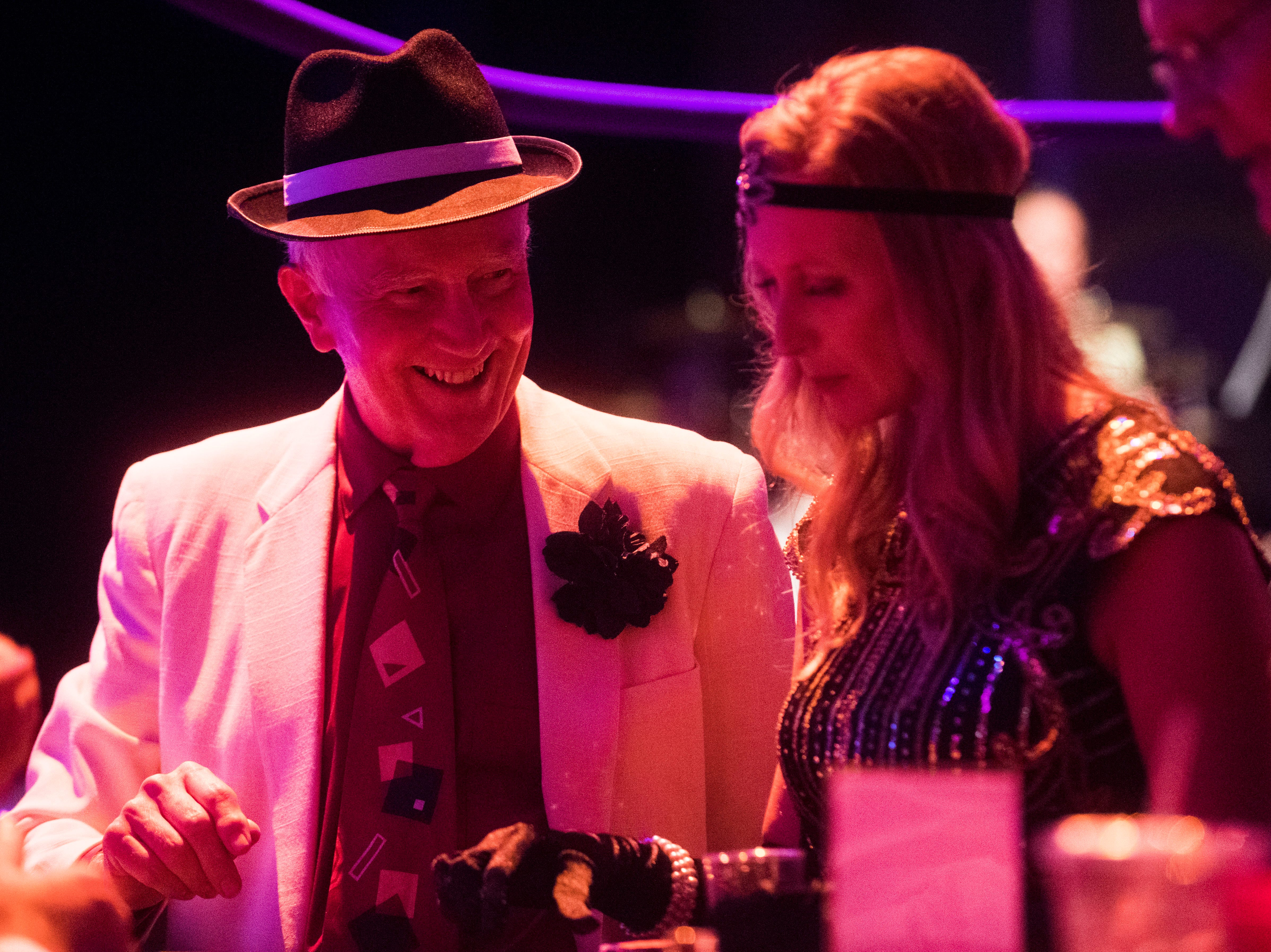 At left Glenn Swift of Knoxville plays casino games at a Speakeasy celebrating the 90th anniversary of the Tennessee Theatre Saturday  29, 2018.