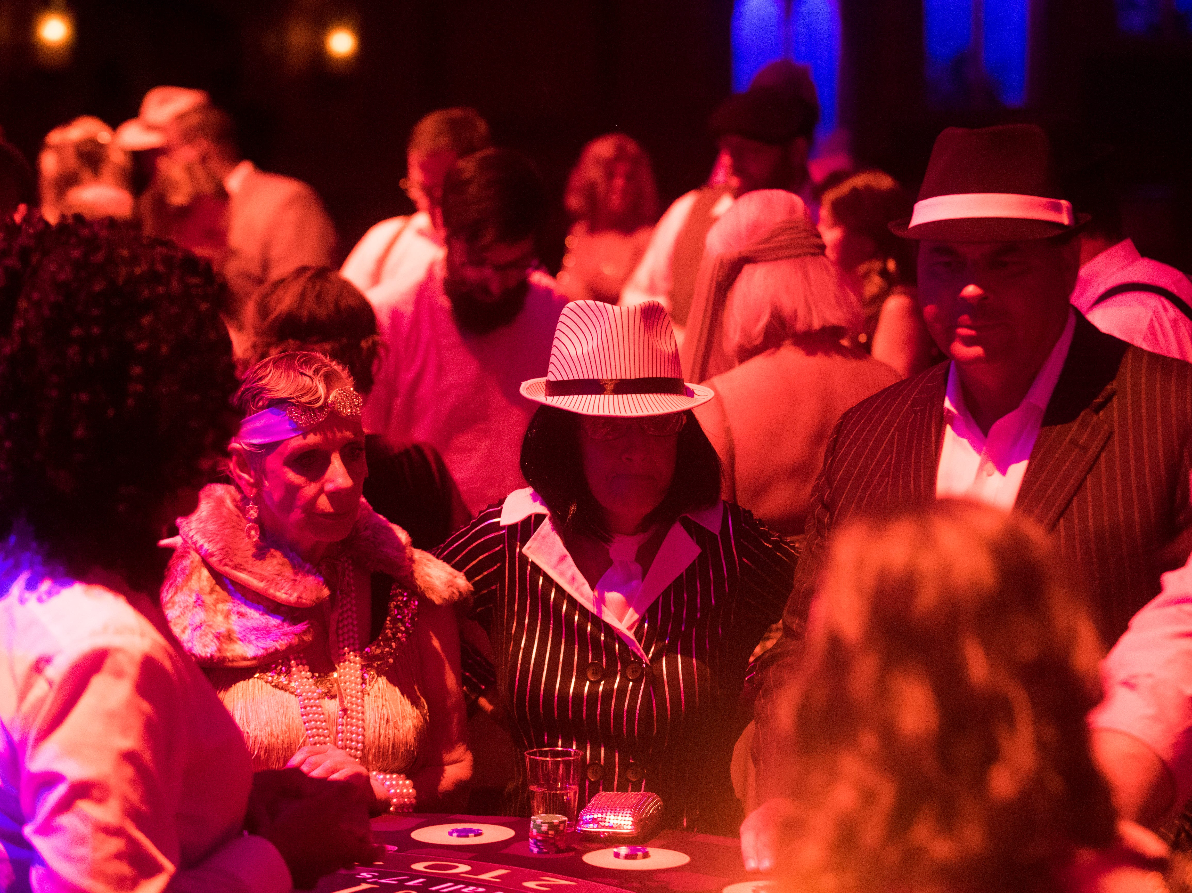 Attendees play casino games at a Speakeasy celebrating the 90th anniversary of the Tennessee Theatre Saturday  29, 2018.