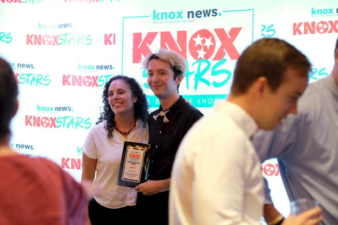 Stacy Palado and Zack Plaster of UTK's McClung Museum of Natural History and Cultrure take a photo with the museum's Best of Knoxville award presented by the Knoxville News Sentinel on Thursday, September 27, 2018 at the Relix Variety Theater in Knoxville.