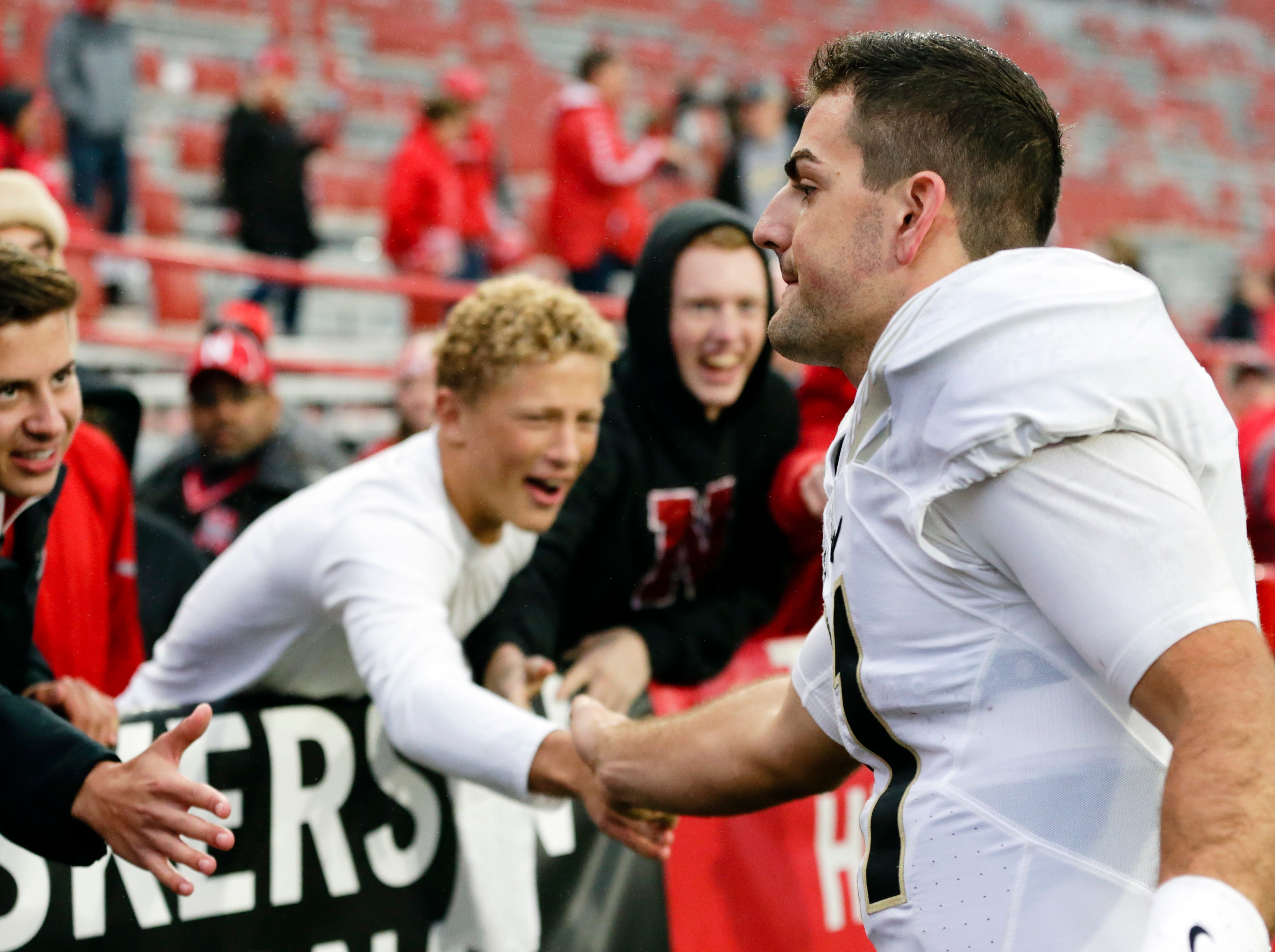 Purdue quarterback David Blough (11) is greeted by supporters follow an NCAA college football game against Nebraska in Lincoln, Neb., Saturday, Sept. 29, 2018. Purdue won 42-28. (AP Photo/Nati Harnik)