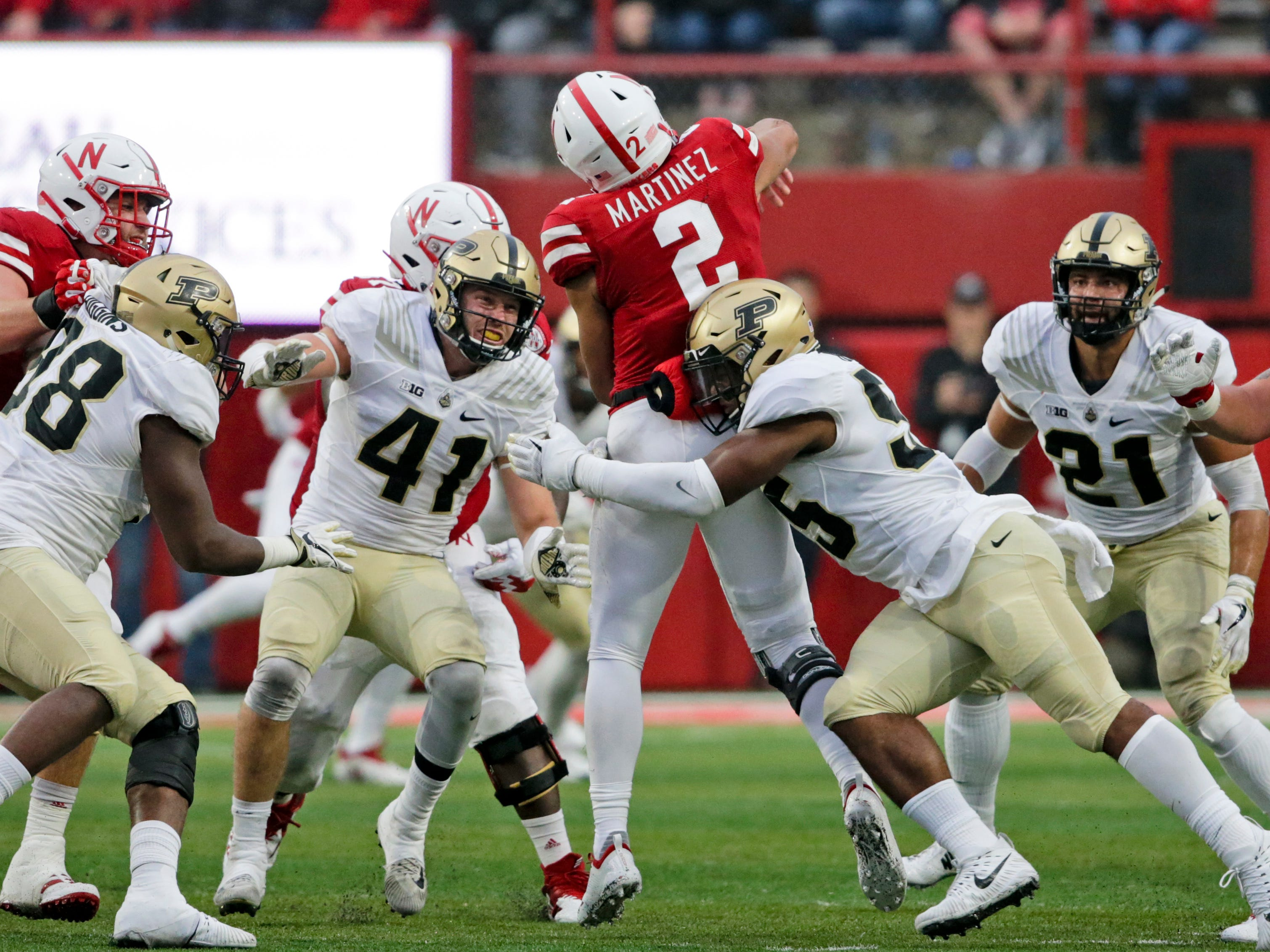 Purdue linebacker Derrick Barnes (55) and safety Jacob Thieneman (41) pressure Nebraska quarterback Adrian Martinez (2) during the second half of an NCAA college football game in Lincoln, Neb., Saturday, Sept. 29, 2018. Purdue won 42-28. (AP Photo/Nati Harnik)