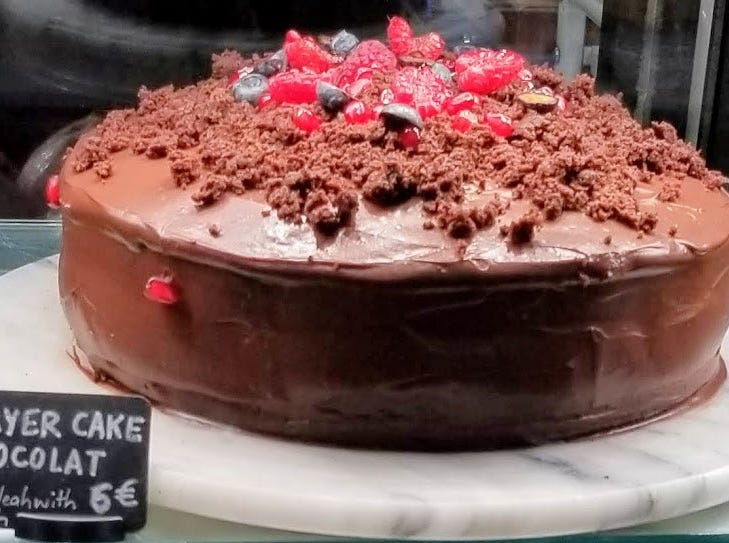 A chocolate layer cake was among the tempting foods in Paris.