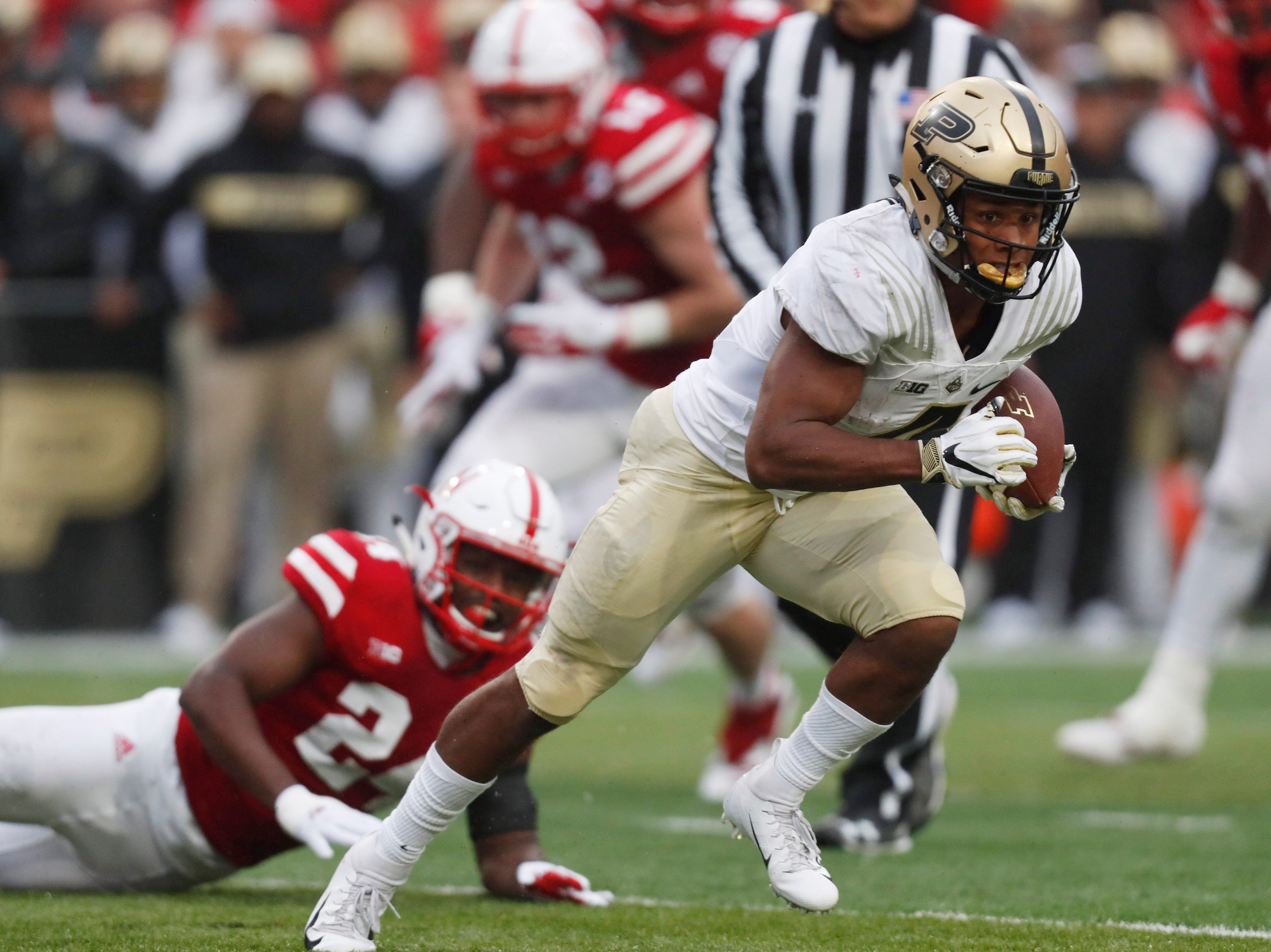 Sep 29, 2018; Lincoln, NE, USA; Purdue Boilermakers wide receiver Rondale Moore (4) runs against the Nebraska Cornhuskers in the second half at Memorial Stadium. Purdue won 42-28. Mandatory Credit: Bruce Thorson-USA TODAY Sports
