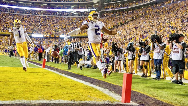 LSU wide receiver Justin Jefferson (2) scores on a 65-yard pass from quarterback Joe Burrow to give the Tigers a 28-3 lead in the second quarter over Ole Miss in Tiger Stadium Saturday Sept. 29, 2018.