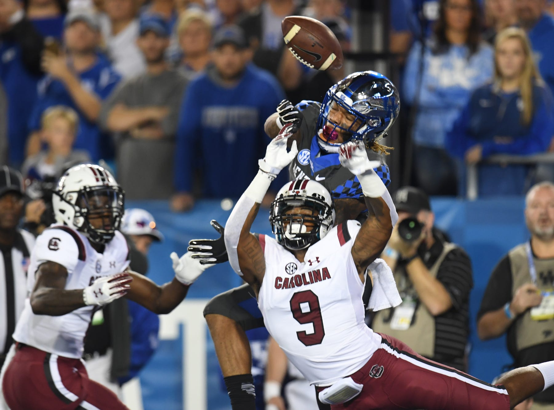 USC defenders break up a pass intended for UK WR Lynn Bowden, Jr. during the University of Kentucky football game against South Carolina at Kroger Field in Lexington, Kentucky on Saturday, September 29, 2018.