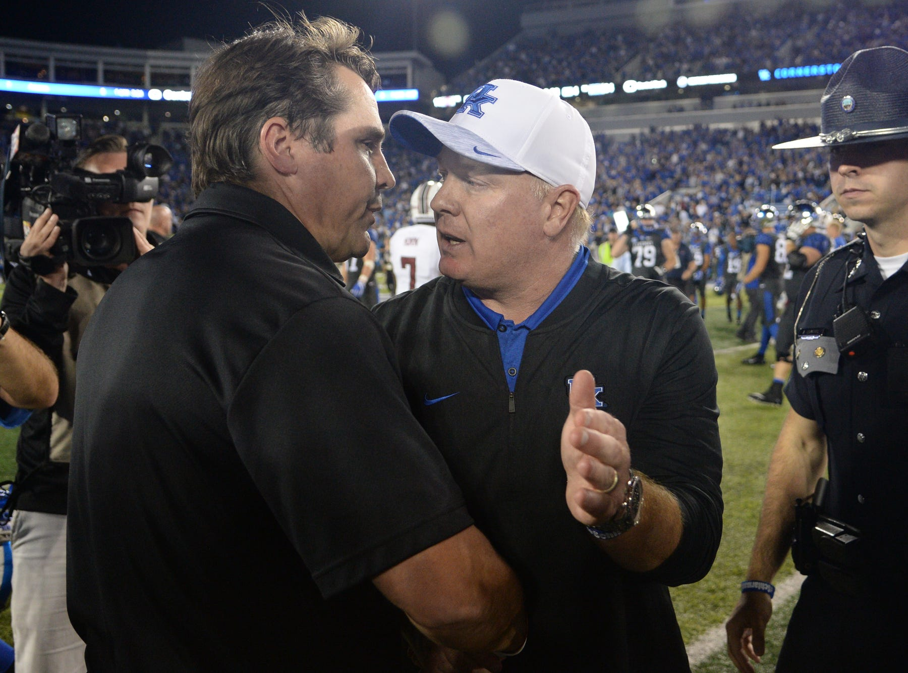 UK head coach Mark Stoops shakes hands with USC head coach Will Muschamp after winning the University of Kentucky football game against South Carolina at Kroger Field in Lexington, Kentucky on Saturday, September 29, 2018.