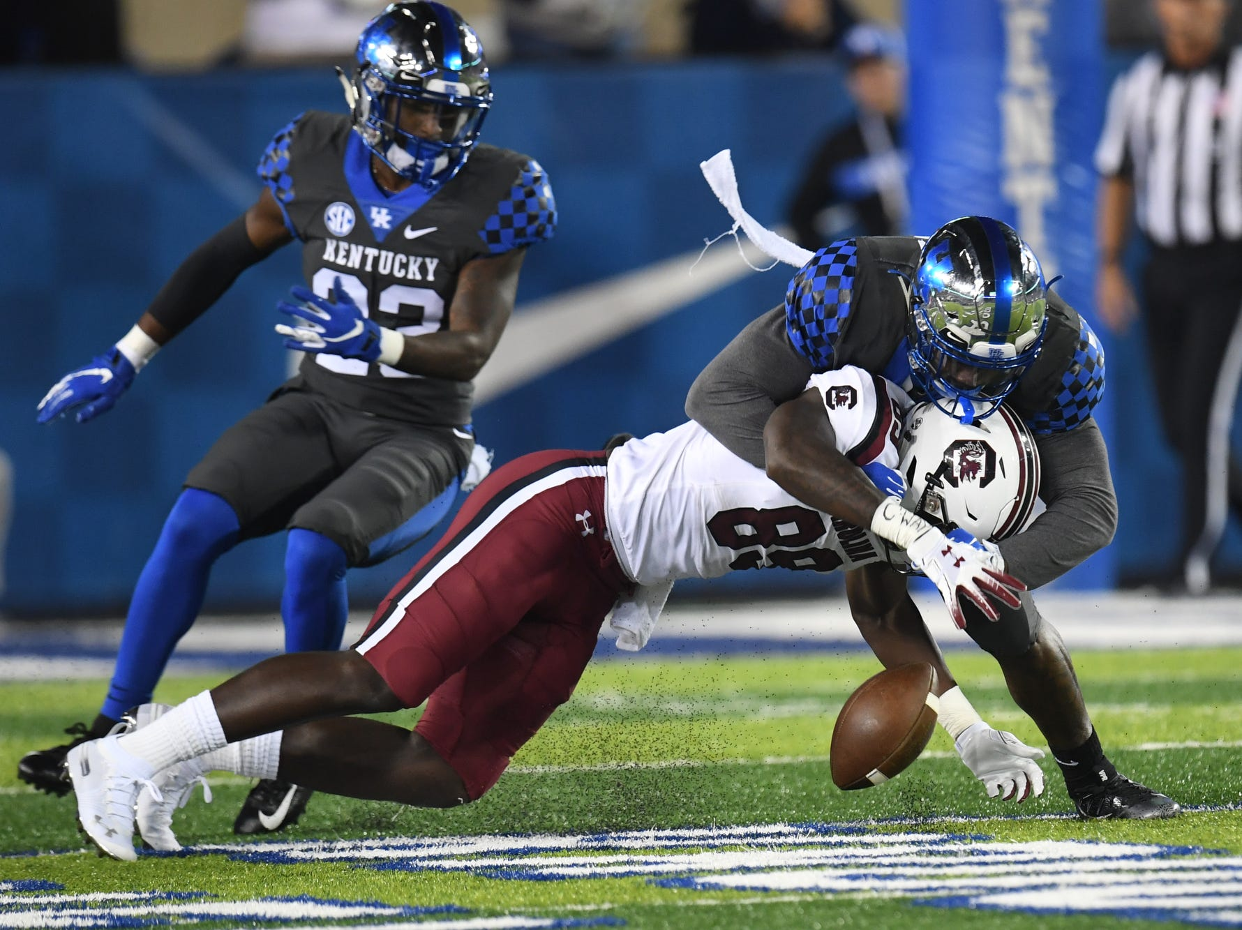 UK defense breaks up a pass during the University of Kentucky football game against South Carolina at Kroger Field in Lexington, Kentucky on Saturday, September 29, 2018.