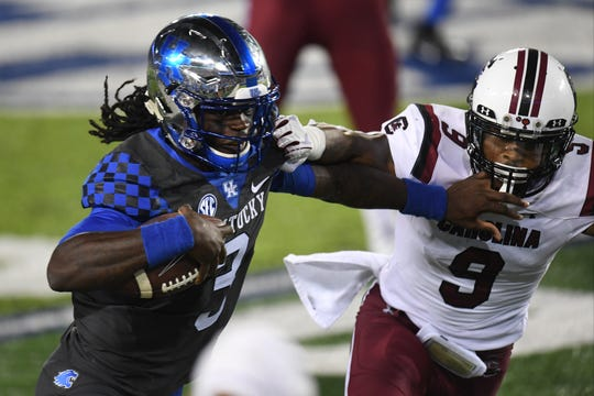 Terry Wilson runs the ball in UK's game vs. South Carolina.