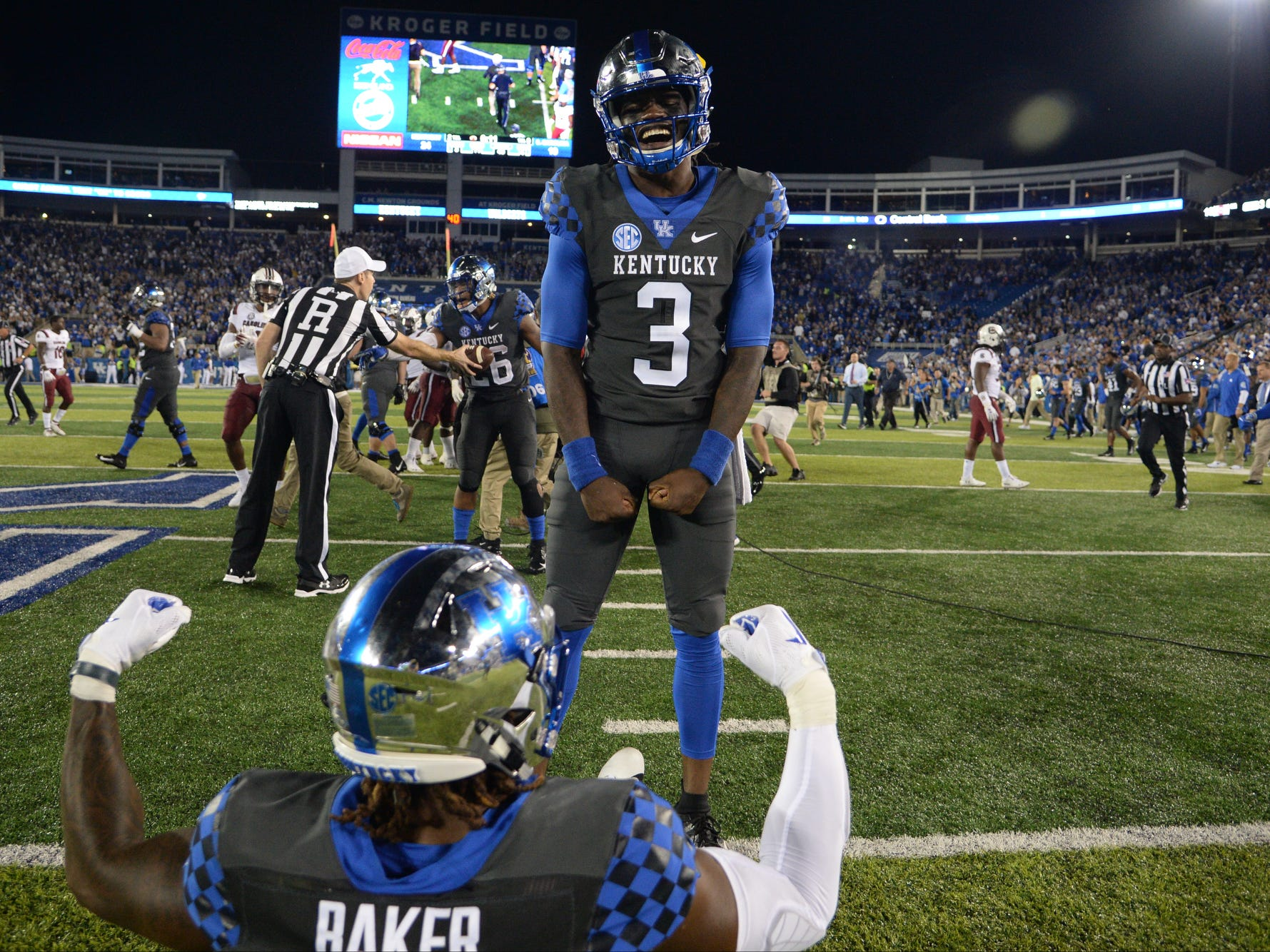 UK QB Terry Wilson celebrates with WR Dorian Baker after winning the University of Kentucky football game against South Carolina at Kroger Field in Lexington, Kentucky on Saturday, September 29, 2018.