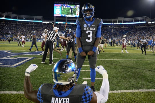 Kentucky quarterback Terry Wilson and the Wildcats celebrate during Saturday's win over South Carolina. Confident UK fans can reserve postseason tickets now.
