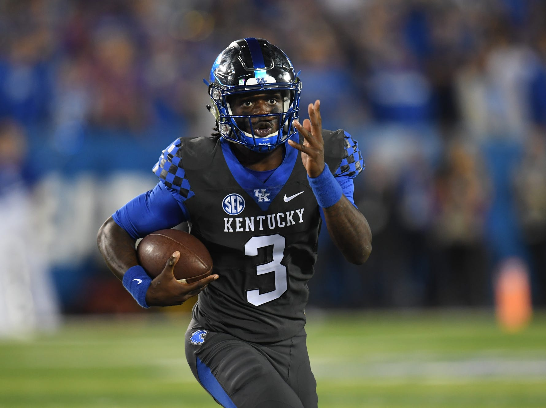 UK QB Terry Wilson runs the ball during the University of Kentucky football game against South Carolina at Kroger Field in Lexington, Kentucky on Saturday, September 29, 2018.