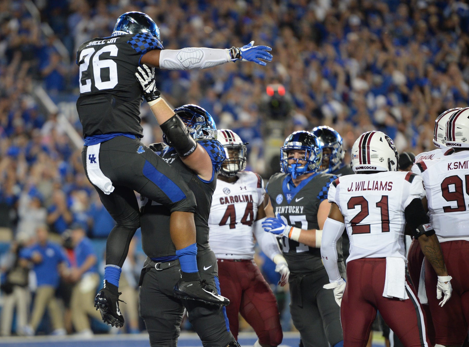 UK RB Benny Snell Jr. celebrates a touchdown during the University of Kentucky football game against South Carolina at Kroger Field in Lexington, Kentucky on Saturday, September 29, 2018.