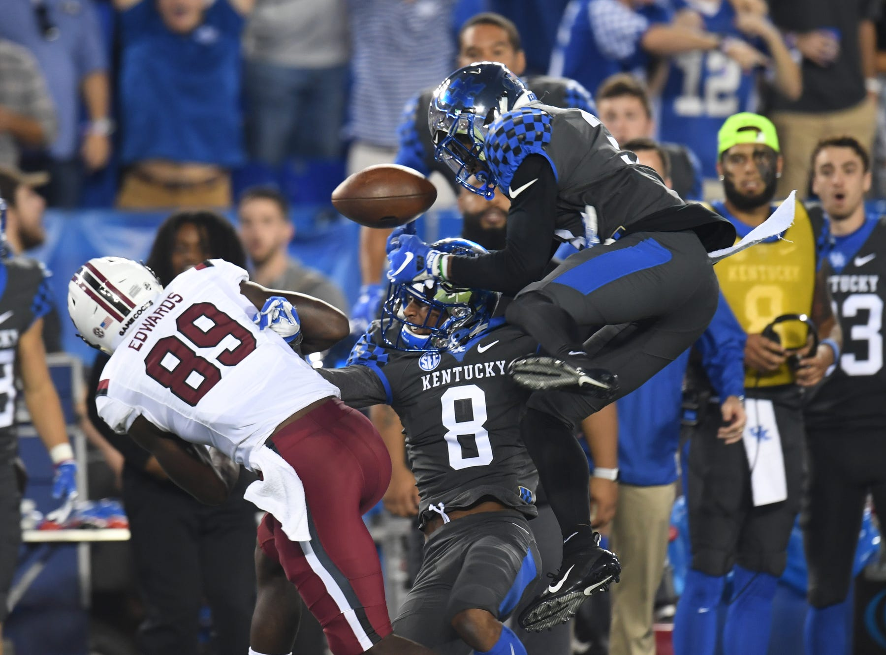 UK defenders break up a pass during the University of Kentucky football game against South Carolina at Kroger Field in Lexington, Kentucky on Saturday, September 29, 2018.