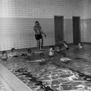 The YMCA offered organized swim classes, as well as family swim and other classes, July 7, 1960.