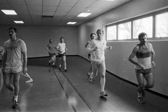 Running on the track during at noontime at the YMCA on Lenawee Street, Jan. 4, 1987.