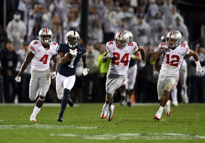 Penn State receiver KJ Hamler has the Ohio State defense in hot pursuit on his 93-yard, catch-and-run touchdown in Saturday's game.