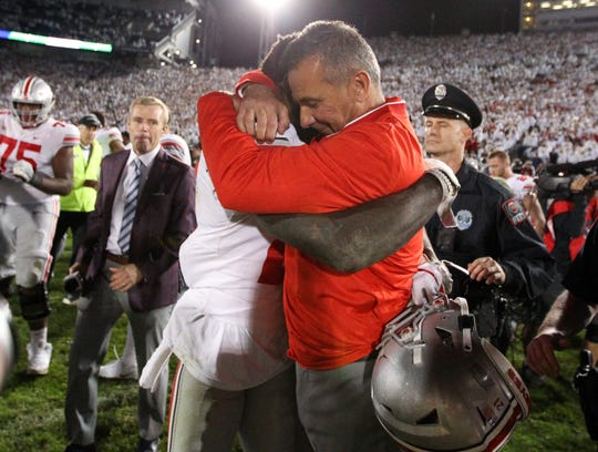 Ohio State coach Urban Meyer hugs H-back Parris Campbell as the Buckeyes celebrate their 27-26 victory at Penn State.