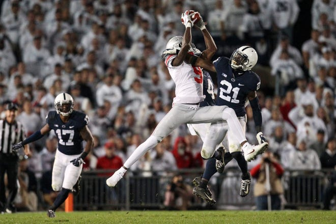 Ohio State receiver Binjimen Victor makes an incredible catch and turns it into a 47-yard touchdown in Saturday's 27-26 win over Penn State.