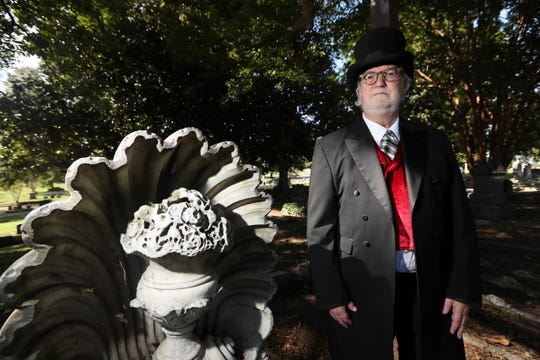 "Willy Bearden, seen here on Sept. 30 at Elmwood Cemetery, is dressed as and representing Charles Fisher, a Memphis businessman who became head of the ""citizens relief committee"" during the last of the city's Yellow Fever epidemics. Fisher died after contracting the disease in 1878."