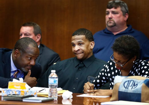 Defendant Quinton Tellis (middle) looks on as the jury goes to deliberate his case, as his defense attorneys Alton Peterson (left) and Darla Palmer (right) confer on the sixth day of his retrial in Batesville, Mississippi on Sunday, September 30, 2018. Tellis is charged with burning 19-year-old Jessica Chambers to death almost three years ago on Dec. 6, 2014. Tellis has pleaded not guilty to the murder.