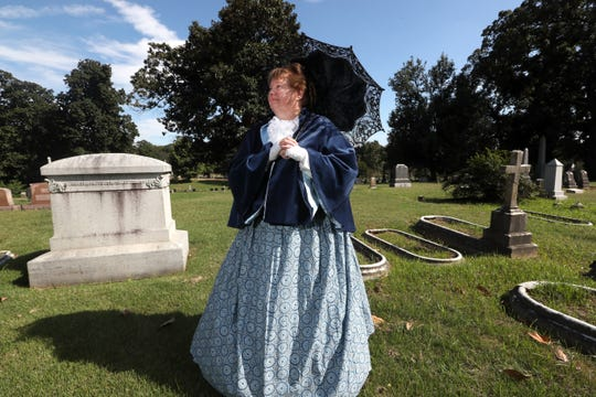 Pam Rumage, dresses as and represents Susan Winchester Scales, who lived 101 years until 1954, experiencing the transition from the beginnings of Memphis to its contemporary form. Rumage posed for a portrait at the Elmwood Cemetery on Saturday.
