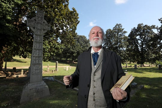 "Vincent Astor, dressed as and representing James Davis, a 19th-century journalist who authored one of the first ""history of Memphis"" books, poses for a portrait at Elmwood Cemetery on Saturday.. Astor is participating in an Oct. 25-27 event in which volunteers portray notable people buried at Elmwood."