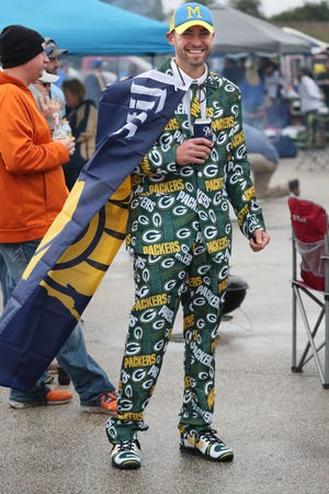 Fans tailgate before the game.  Toby Probst of Cambridge wore his Green Bay Packers suit, his Brewers hat and cape while at Miller Park.  The Packer game started a few hours ahead of the Brewers at Miller Park where the Brewers played the Tigers looking for a regular playoff berth.