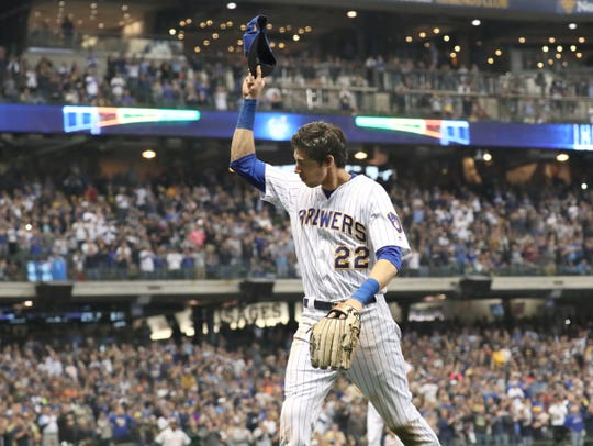 The Milwaukee Brewers' Christian Yelich doffs his cap to the fans Sunday in the regular-season finale at Miller Park Sunday.