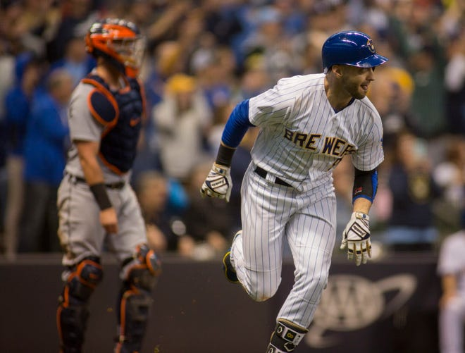 Milwaukee's Ryan Braun hits a two-run RBI double against the Detroit Tigers during Sunday's 11-0 Brewers victory at Miller Park in Milwaukee.