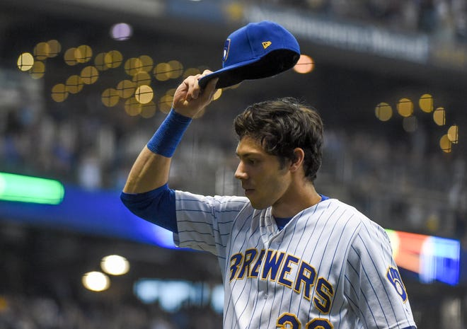 Sep 30, 2018; Milwaukee, WI, USA;  Milwaukee Brewers right fielder Christian Yelich (22) tips his cap to fans who gave him a standing ovation after he was taken out of the game against the Detroit Tigers in the eighth inning  at Miller Park. Mandatory Credit: Benny Sieu-USA TODAY Sports