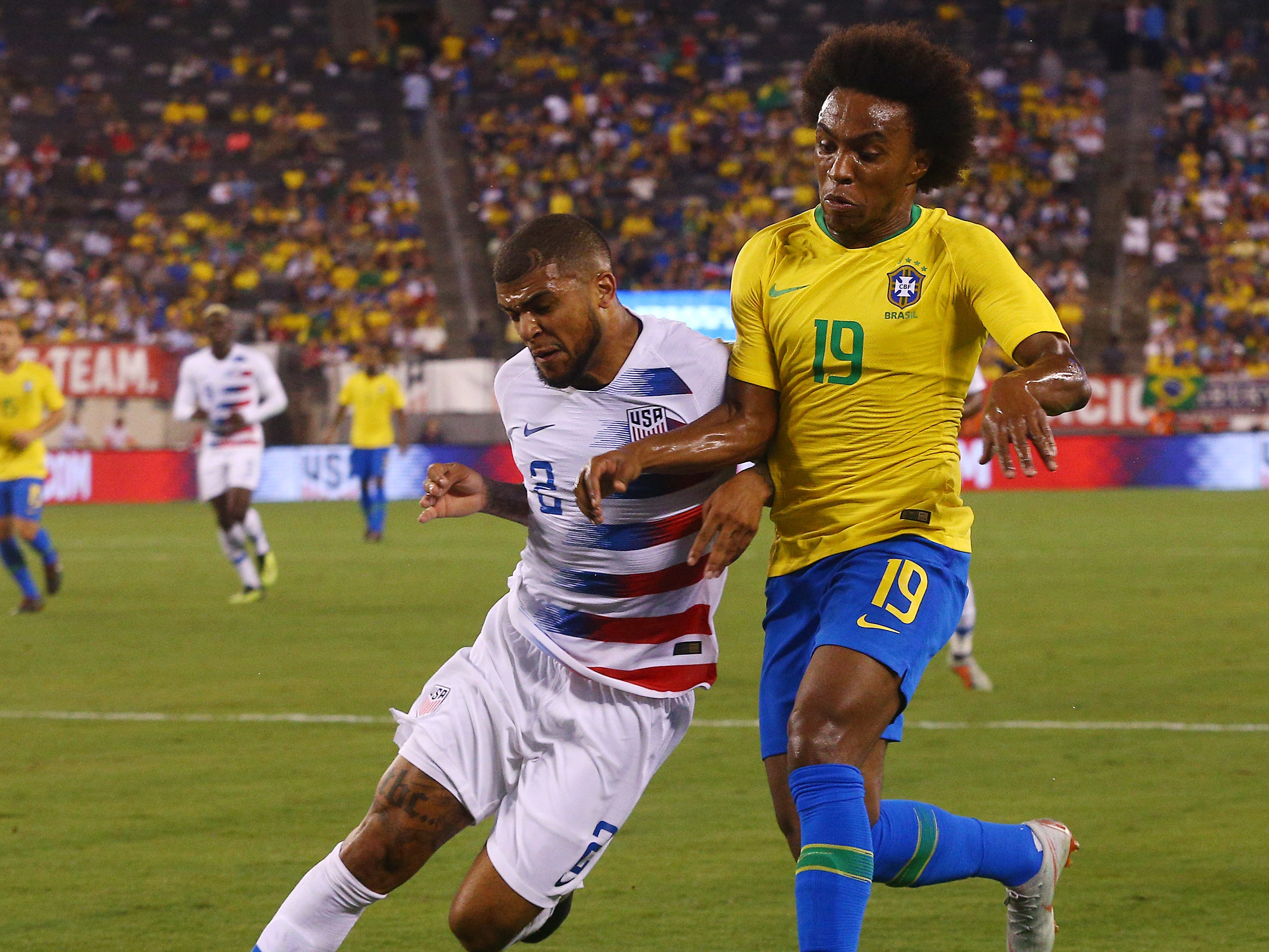 U.S. Men's National Team's DeAndre Yedlin defends on Brazil's Willian during their international friendly at MetLife Stadium in East Rutherford, N.J. The US was defeated 2-0 by the five-time World Cup champions. September 7, 2018, East Rutherford, NJ