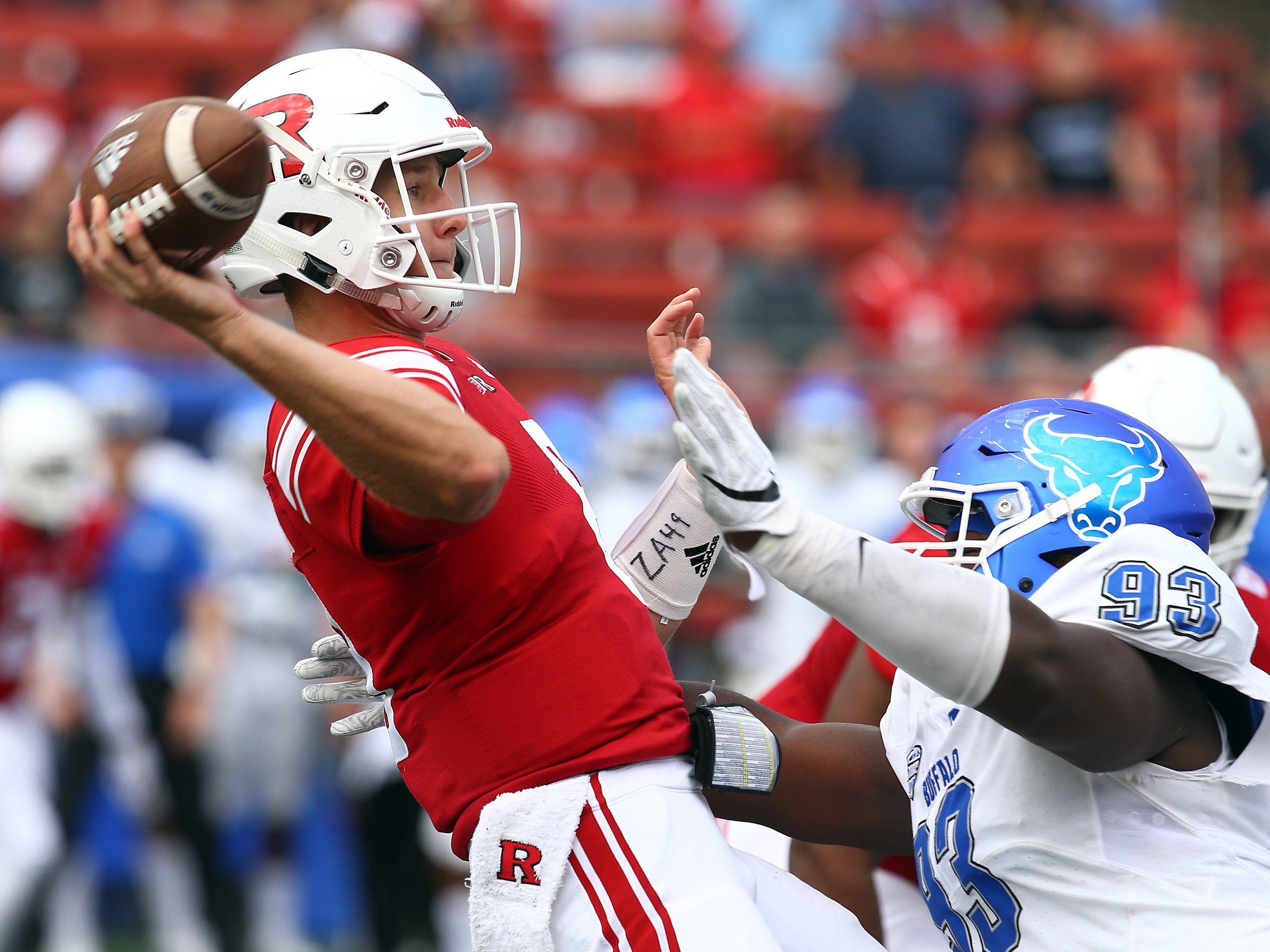 Rutgers Scarlet Knights quarterback Artur Sitkowski is rushed by Buffalo Bulls Chibueze Onwuka at HighPoint.com Stadium in Piscataway. September 22, 2018, Piscataway, NJ
