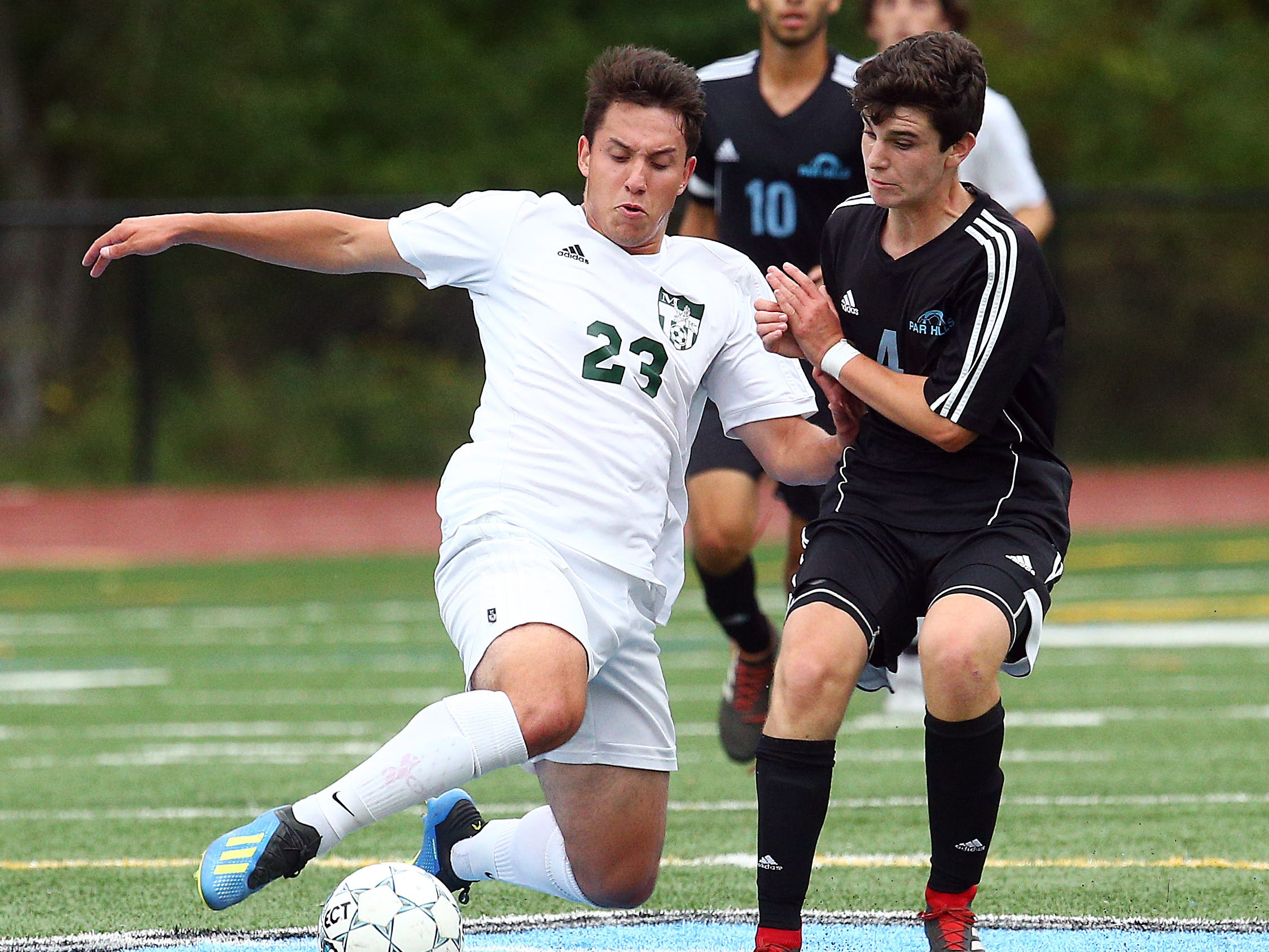 Morris Knolls Max Panagiotou vs. Parsippany Hills Anton Leyzerov during their boys soccer match. September 27, 2018, Parsippany, NJ