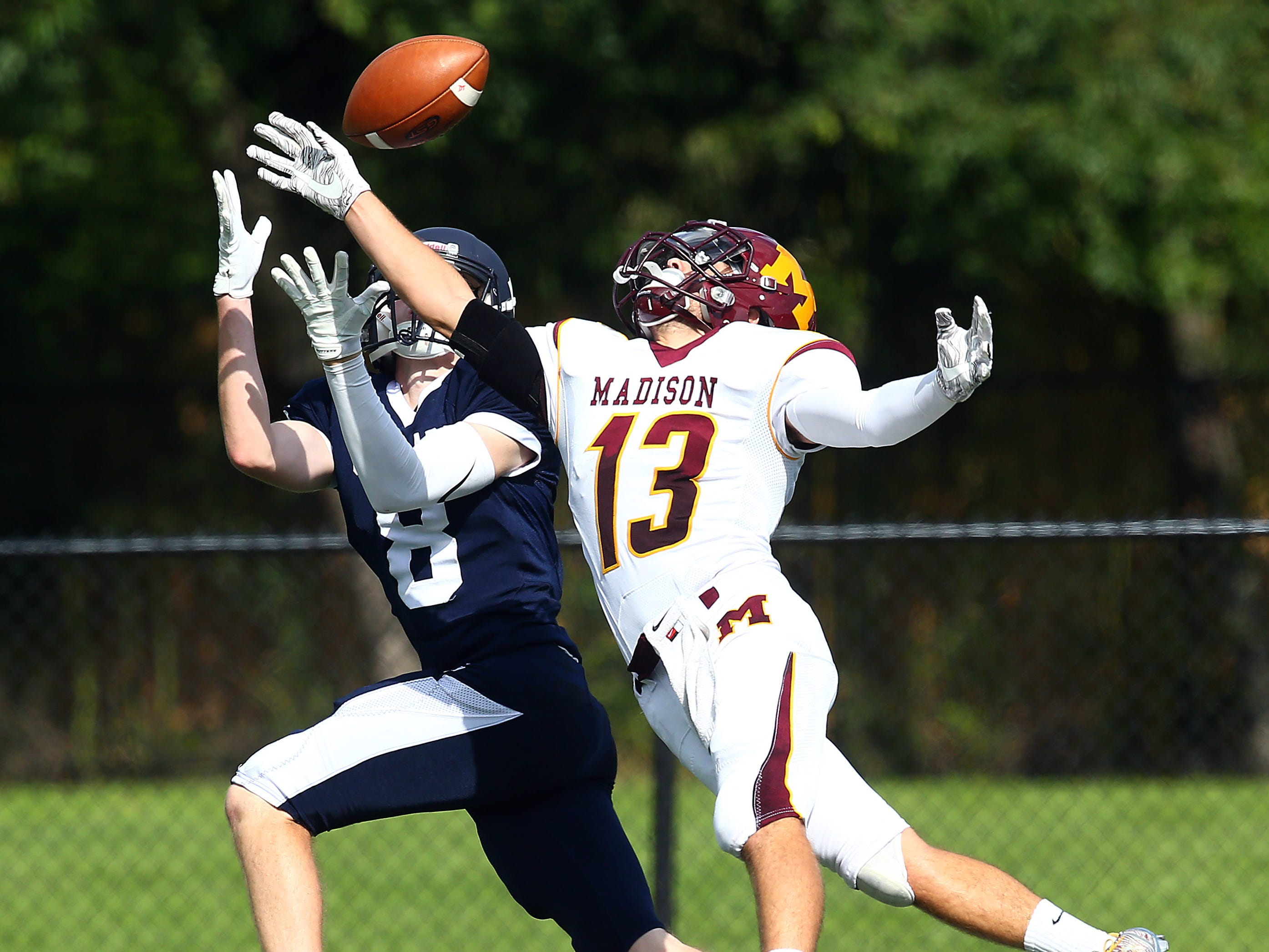 Madison's Brendan Quinn breaks up a deep pass to Chatham intended receiver Shane Carlin during their SFC American White Saturday football game. September 29, 2018, Chatham, NJ
