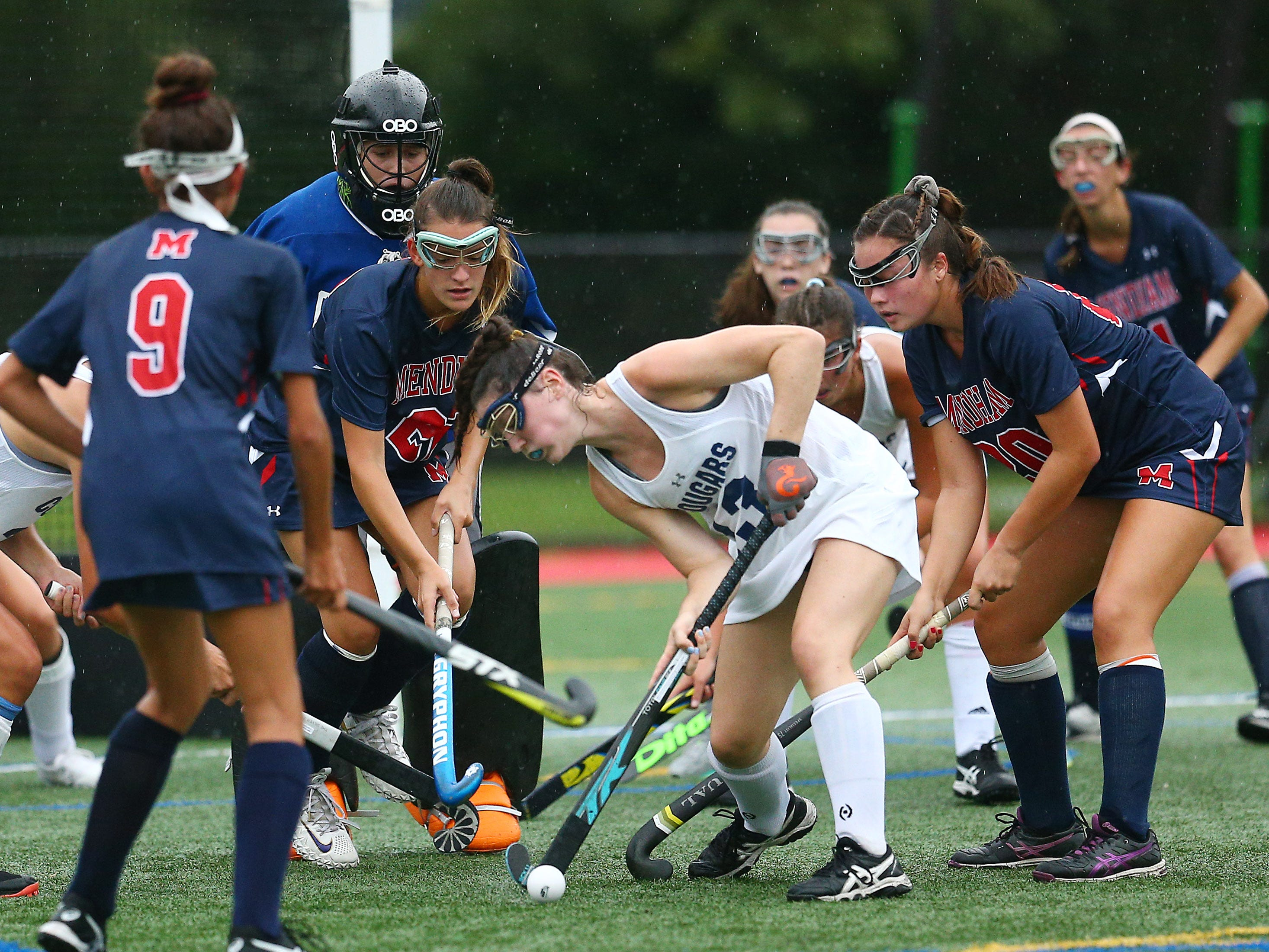 Chatham's Charlotte Hamilton clears the ball vs. Mendham during their NJAC-American field hockey game at Haas Field in Chatham. September 12, 2018, Chatham, NJ