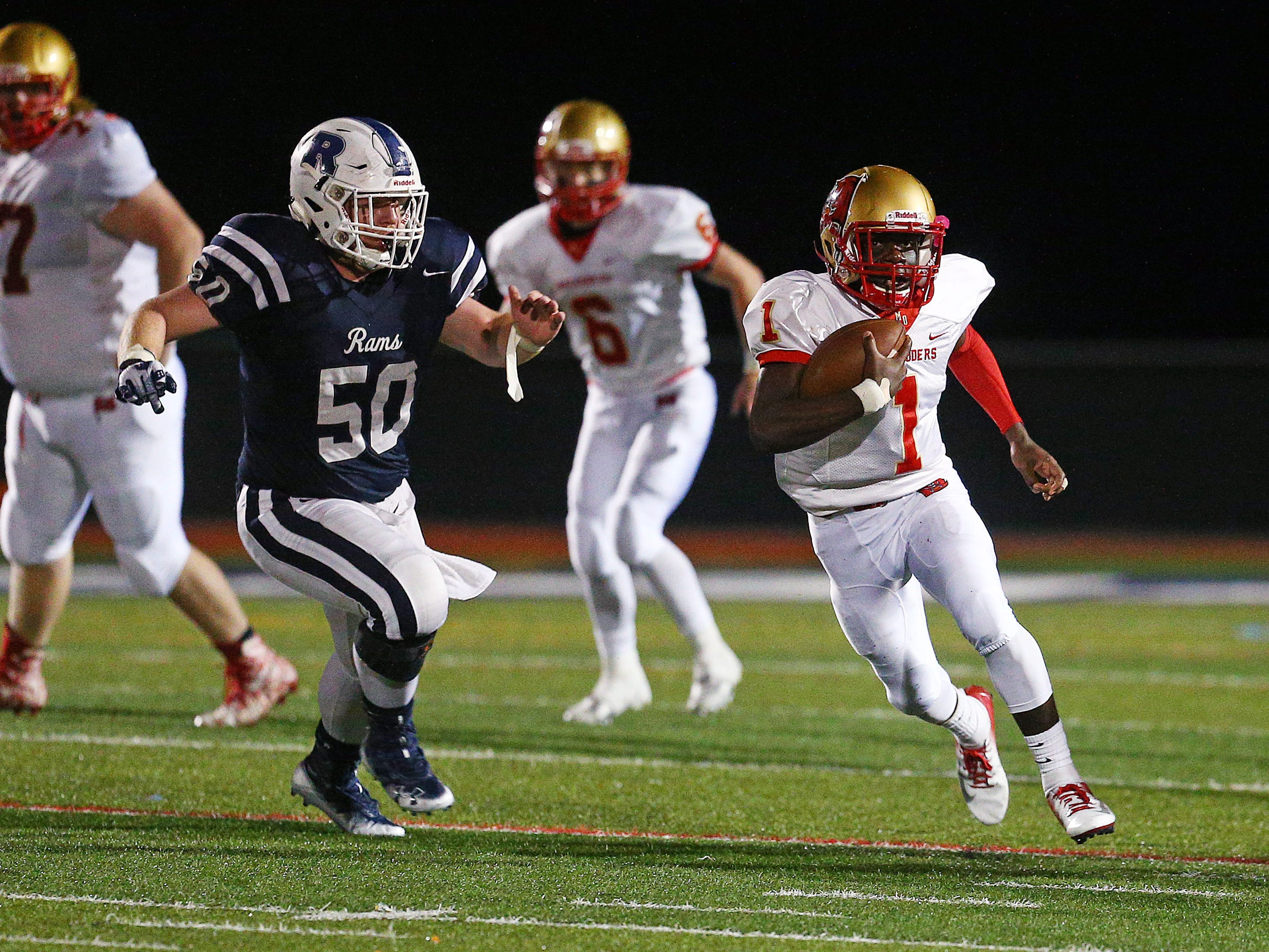 Mount Olive quarterback Tamar Albritton gains yardage on a keeper vs. Randolph during their SFC Freedom Blue Friday night football game. September 28, 2018, Randolph, NJ