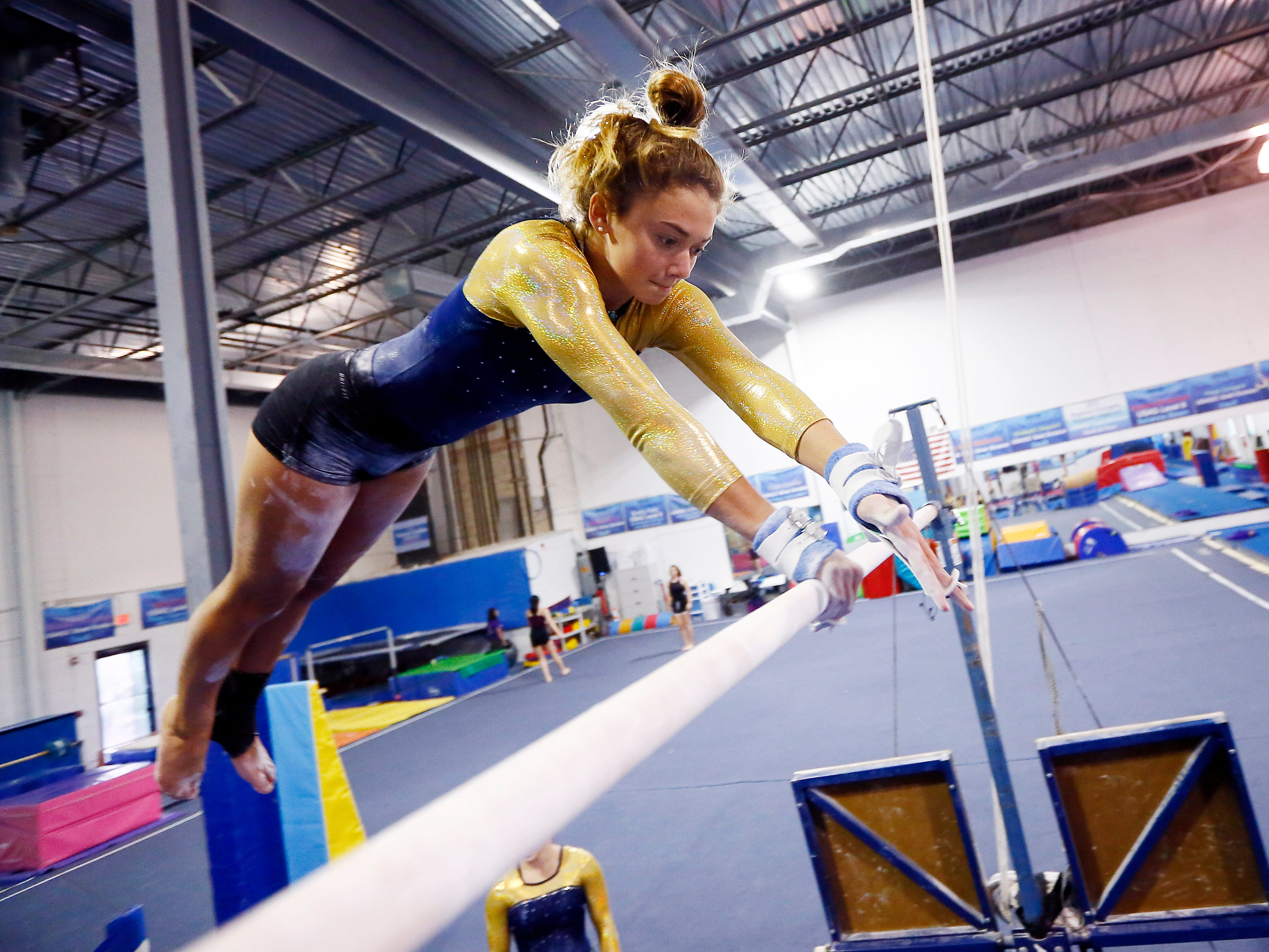 Roxbury High School junior Ashley Miller works on the uneven bar during gymnastics practice at Northern Elite Gymnastics & Cheer in Flanders. Roxbury has just launched a girls gymnastics team.  September 25, 2018, Flanders, NJ