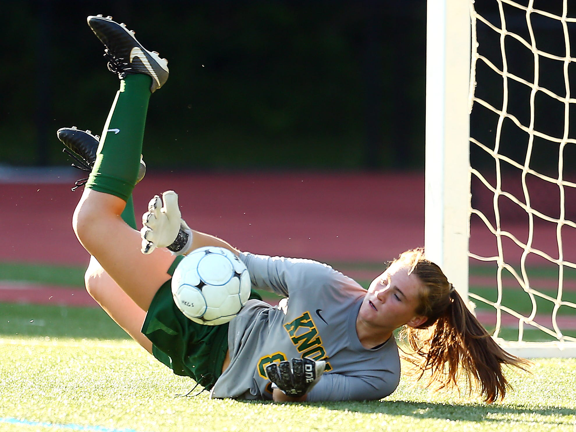 Morris Knolls goalkeeper Kate Walsh stops a shot on goal vs. Randolph in a NJAC-American girls soccer season opener. Morris Knolls coach Stephan Zdanowicz got her 200th career victory in the 2-0 win at home. September 5, 2018, Denville, NJ