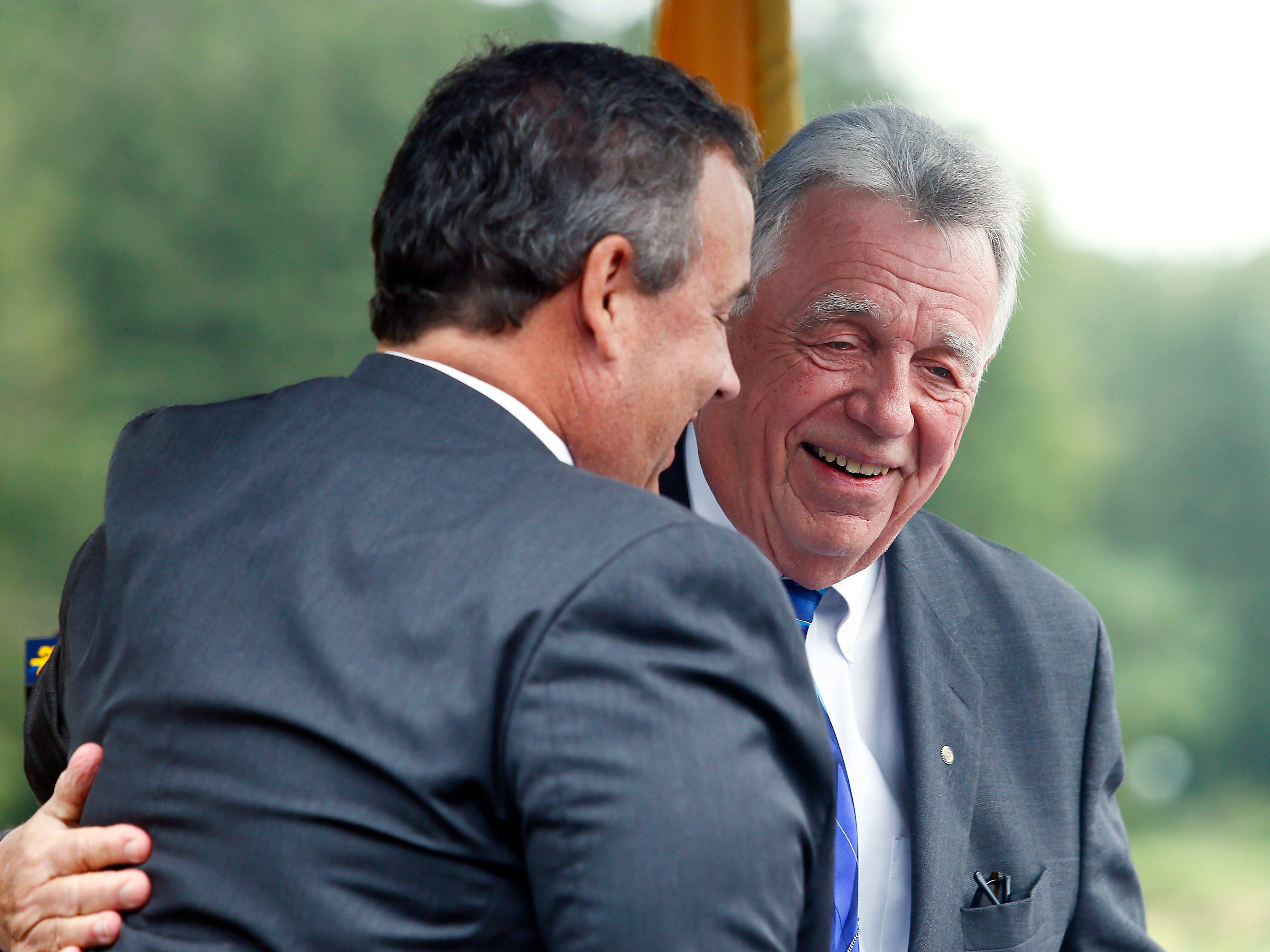 Morris Plains Mayor Frank Druetzler gives a hug to former New Jersey Governor Chris Christie as Morris County freeholders formally open Gov. Chris Christie Drive, a new main access road to Central Park of Morris County. September 12, 2018, Morris Plains, NJ