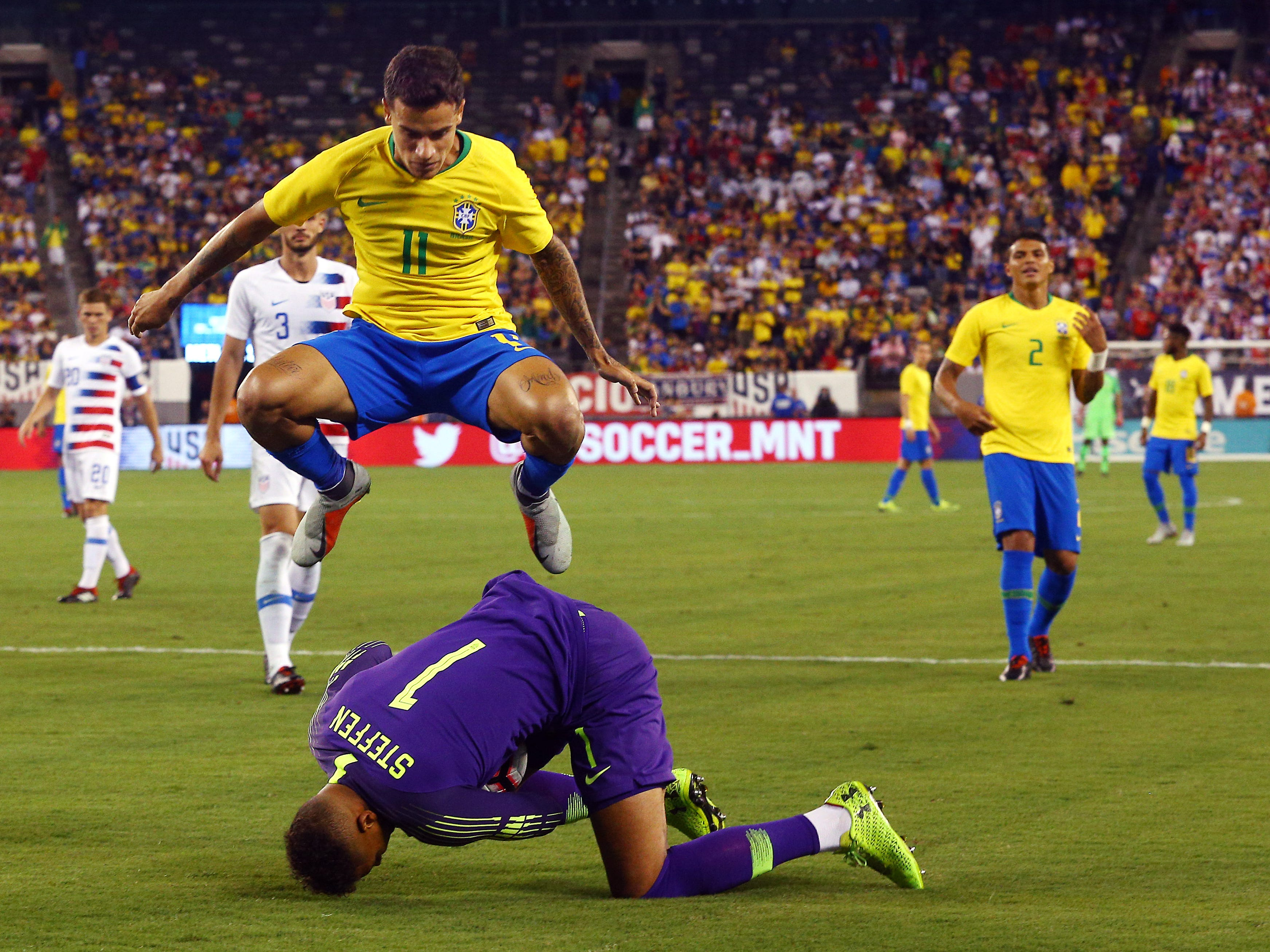 Brazil's Philippe Coutinho leaps over U.S. Men's National Team goalkeeper Zack Steffen during their international friendly at MetLife Stadium in East Rutherford, N.J. The US was defeated 2-0 by the five-time World Cup champions. September 7, 2018, East Rutherford, NJ
