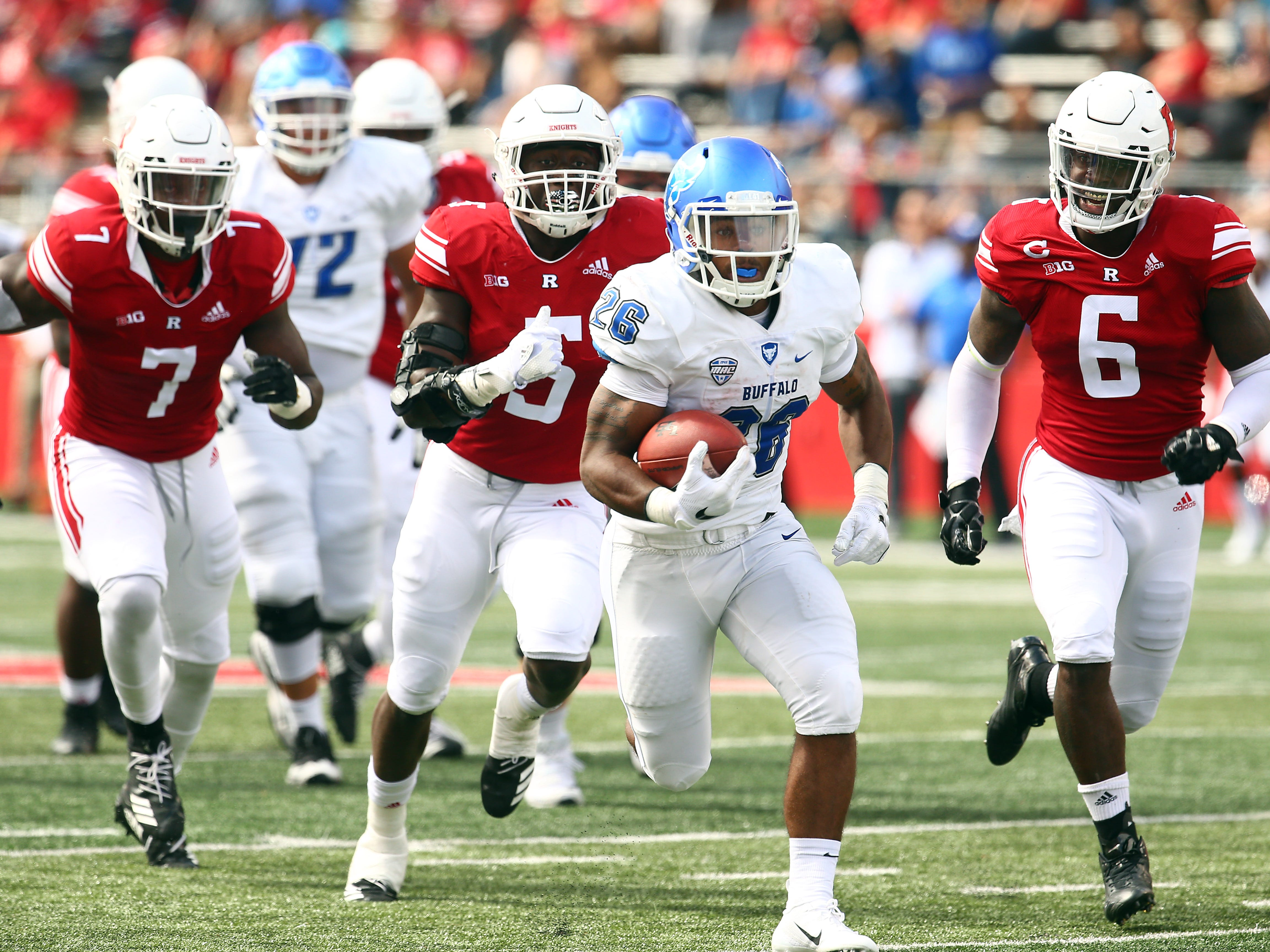 Buffalo Bulls running back Jaret Patterson is chased by three Rutgers Scarlet Knights on his way to a first half touchdown at HighPoint.com Stadium in Piscataway. September 22, 2018, Piscataway, NJ